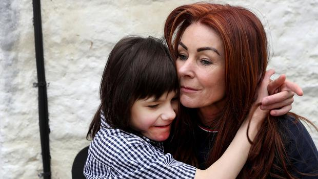 Charlotte Caldwell and her 12 year old son Billy at their Castlederg home in Co Tyrone. Last year Billy became the first in the UK to get legally-prescribed cannabis oil on the NHS for his severe epilepsy. Pic: William Cherry Presseye
