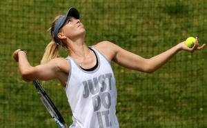 LONDON, ENGLAND - JUNE 25:  Maria Sharapova of Russia serves during a practice session on day two of the Wimbledon Lawn Tennis Championships at the All England Lawn Tennis and Croquet Club on June 25, 2013 in London, England.  (Photo by Dan Kitwood/Getty Images)