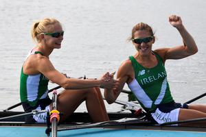 Ireland's Sinead Lynch (R) and Claire Lambe celebrate after the LWT Women's Double Sculls semifinal rowing competition at the Lagoa stadium during the Rio 2016 Olympic Games in Rio de Janeiro on August 11, 2016. AFP/Getty Images