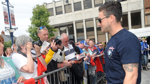 Simon Andrews poses for pictures with race fans earlier this week at the North West 200. Pic Stephen Davison