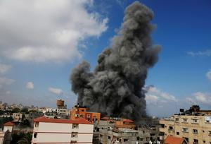 Smoke rises after an Israeli strike hit the offices of the Hamas movement's Al-Aqsa satellite TV station, in Gaza City, northern Gaza Strip, Thursday, July 31, 2014. (AP Photo/Hatem Moussa)