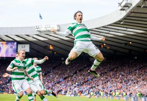 Celtic's Erik Sviatchenko celebrates scoring his sides opening goal during the William Hill Scottish Cup semi-final match at Hampden Park, Glasgow. PRESS ASSOCIATION Photo. Picture date: Sunday April 17, 2016. See PA story SOCCER Rangers. Photo credit should read: Jeff Holmes/PA Wire. EDITORIAL USE ONLY