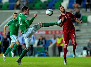 Kyle Lafferty (L) of Northern Ireland and Attila Fiola (R) of Hungary in action during the Euro 2016 Group F qualifying match at Windsor Park on September 7, 2015 in Belfast, Northern Ireland.  (Photo by Charles McQuillan/Getty Images)