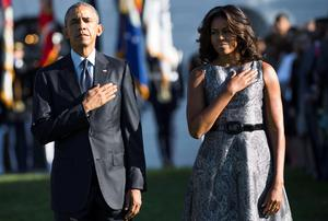 US President Barack Obama and First Lady Michelle Obama stand on the South Lawn of the White House in Washington, DC, September 11, 2015, to mark the 14th anniversary of the 9/11 attacks on the United States. AFP PHOTO / SAUL LOEBSAUL LOEB/AFP/Getty Images