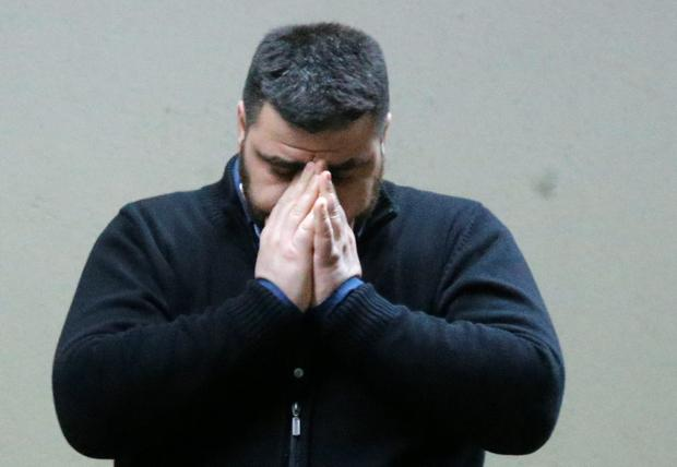 A man who appears to have waited for the missing flight 4U 9525 covers his face at the airport in Duesseldorf, Germany, Tuesday, March 24, 2015, after a Germanwings passenger jet carrying 148 people crashed in the French Alps region as it traveled from Barcelona to Duesseldorf. (AP Photo/Frank Augstein)