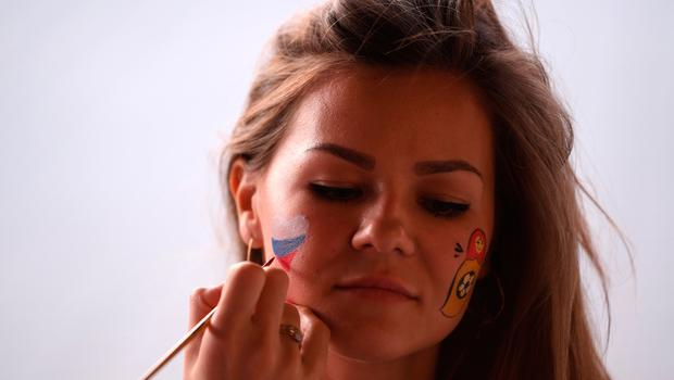 ROSTOV-ON-DON, RUSSIA - JULY 02:  A fan has their face painted prior to the 2018 FIFA World Cup Russia Round of 16 match between Belgium and Japan at Rostov Arena on July 2, 2018 in Rostov-on-Don, Russia.  (Photo by Laurence Griffiths/Getty Images)