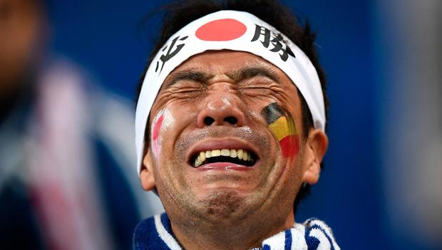 ROSTOV-ON-DON, RUSSIA - JULY 02:  A Japan fan looks dejected following their sides defeat in the 2018 FIFA World Cup Russia Round of 16 match between Belgium and Japan at Rostov Arena on July 2, 2018 in Rostov-on-Don, Russia.  (Photo by Carl Court/Getty Images)