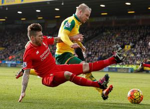 Liverpool's Spanish defender Alberto Moreno (L) vies with Norwich CityÕs Scottish striker Steven Naismith during the English Premier League football match between Norwich City and Liverpool at the Carrow Road stadium in Norwich, Norfolk, England on January 23rd, 2015. AFP PHOTO / LINDSEY PARNABY  RESTRICTED TO EDITORIAL USE. No use with unauthorized audio, video, data, fixture lists, club/league logos or 'live' services. Online in-match use limited to 75 images, no video emulation. No use in betting, games or single club/league/player publications.LINDSEY PARNABY/AFP/Getty Images