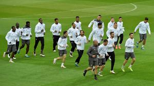 Liverpool players exercise during a training session in the Dortmund stadium prior to the Europa League quarterfinal soccer match between Borussia Dortmund and Liverpool FC in Dortmund, Germany, Wednesday, April 6, 2016. (AP Photo/Martin Meissner)
