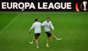 Liverpool's Adam Lallana, right, attends a training session in the Dortmund stadium prior the Europa League quarterfinal  soccer match between Borussia Dortmund and Liverpool FC in Dortmund, Germany, Wednesday, April 6, 2016. (AP Photo/Martin Meissner)