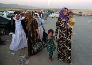 Displaced Iraqis from the Yazidi community arrive to the camp of Bajid Kandala at Feeshkhabour town near the Syria-Iraq border, Iraq Saturday, Aug. 9, 2014. (AP Photo/ Khalid Mohammed)