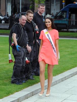 Work men at Belfast City Hall get a look at Newly Crowned Beauty Rebekah Shirley  on her first day as  The Open + Direct Miss Northern Ireland 2014, with 13 Heats across NI, Beating 26 Finalists from13 Heats across NI with the final being held in the Europa Hotel Belfast on Monday evening. Photo Kirth Ferris/Pacemaker Press
