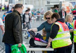 A lady has her backpack checked by a member of security before the international friendly match between Northern Ireland against New Zealand at Windsor Park, Belfast.  Liam McBurney/PA Wire.