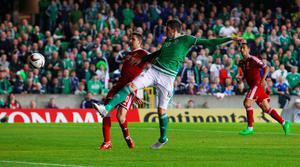 Northern Ireland's Kyle Lafferty (right) during the UEFA European Championship Qualifying match at Windsor Park, Belfast. PRESS ASSOCIATION Photo. Picture date: Monday September 7, 2015. See PA story SOCCER N Ireland. Photo credit should read: Niall Carsony/PA Wire