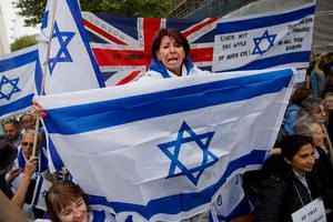 Pro-Israeli demonstrators carry the Israeli flag as they rally in support of the planned visit of Israeli Prime Minister Benjamin Netanyahu outside the gates of Downing Street in London on September 9, 2015. Over 100 pro-Israeli demonstrators and hundreds of pro-Palestinian activists rallied in front of Downing Street in London ahead of a planned visit of Israeli Prime Minister Benjamin Netanyahu. Netanyahu visits Britain this week for talks with his counterpart David Cameron as the right-wing Israeli leader faces diplomatic pressure over West Bank settlements and stalled peace efforts. AFP PHOTO / JUSTIN TALLISJUSTIN TALLIS/AFP/Getty Images
