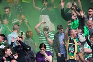 GLASGOW, SCOTLAND - MAY 26: Celtic fans let off flares during the William Hill Scottish Cup Final match between Celtic and Hibernian at Hampden Stadium on May 26, 2013 in Glasgow, Scotland. (Photo by Ian MacNicol/Getty Images)