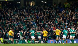Fans celebrate after Ireland's Keith Earls scores a try during the Autumn International match at the Aviva Stadium, Dublin. PRESS ASSOCIATION Photo. Picture date: Saturday November 26, 2016. See PA story RUGBYU Ireland. Photo credit should read: Brian Lawless/PA Wire. RESTRICTIONS: Editorial use only, No commercial use without prior permission