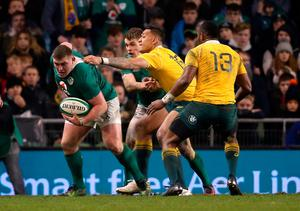 Ireland's Tadhg Furlong is held back by Australia's Israel Folau during the Autumn International match at the Aviva Stadium, Dublin. PRESS ASSOCIATION Photo. Picture date: Saturday November 26, 2016. See PA story RUGBYU Ireland. Photo credit should read: Niall Carson/PA Wire. RESTRICTIONS: Editorial use only, No commercial use without prior permission