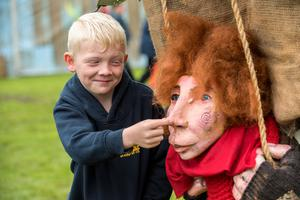 Eight year old Christopher Holmes making friends with one of the characters roaming St.Columb's Park.