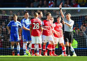 LONDON, ENGLAND - MARCH 22:  Referee Andre Marriner shows Kieran Gibbs of Arsenal a red card during the Barclays Premier League match between Chelsea and Arsenal at Stamford Bridge on March 22, 2014 in London, England.  (Photo by Shaun Botterill/Getty Images)