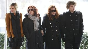 Priscilla Presley, second from left, her daughter, Lisa Marie Presley, second from right, and Lisa Marie's children, Riley Keough, left, and Benjamin Keough, right, take part in a ceremony in Memphis, Tennessee., commemorating Elvis Presley's 75th birthday (Archive/Mark Humphrey/AP)