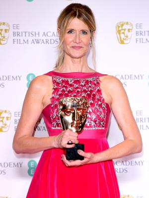 Laura Dern with her award (Ian West/PA)