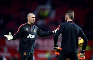 Manchester United's Victor Valdes (left) and David De Gea (right) before the Barclays Premier League match at Old Trafford, Manchester. Martin Rickett/PA Wire.