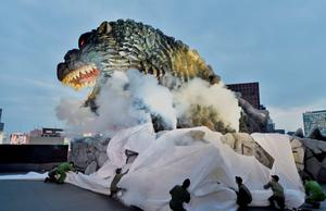 A life-size Godzilla head on a balcony of the eighth floor of Hotel Gracery Shinjuku is displayed during the official unveiling ceremony at Kabukicho shopping district in Tokyo on April 9, 2015. AFP/Getty Images