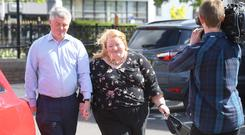 Alliance Party leader Naomi Long and her husband Michael arrive to cast their votes in the local governmant elections this morning at St Colmcille's Parish Church, 191A Upper Newtownards Road, Belfast