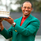 Long wait: Tiger Woods with Green Jacket and Masters trophy