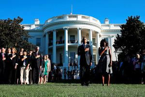 WASHINGTON, DC - SEPTEMBER 11:  US President Barack Obama and first lady Michelle Obama participate in a moment of silence to mark the 14th anniversay of the 911 terror attacks, at the White House on September 11, 2015 in Washington, DC. Today marks the fourteenth anniversary of the September 11, 2001 attacks when terroristists high jacked airliners and flew them in the World Trade Center and the Pentagon.  (Photo by Mark Wilson/Getty Images)