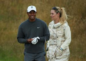 GULLANE, SCOTLAND - JULY 15:  Tiger Woods of the United States smiles alongside skier Lindsey Vonn ahead of the 142nd Open Championship at Muirfield on July 15, 2013 in Gullane, Scotland.  (Photo by Andy Lyons/Getty Images)