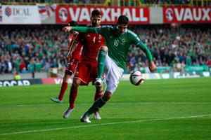 Northern Ireland's Kyle Lafferty (front) and Hungary's Tamas Kadar battle for the ball during the UEFA European Championship Qualifying match at Windsor Park, Belfast. PRESS ASSOCIATION Photo. Picture date: Monday September 7, 2015. See PA story SOCCER N Ireland. Photo credit should read: Niall Carsony/PA Wire