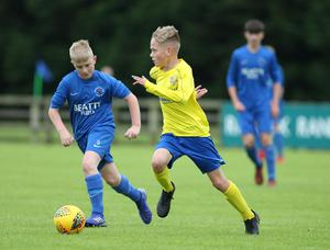 PressEye-Northern Ireland- 29th July  2019-Picture by Brian Little/PressEye Dungannon United Elijah Weathered   and Ballinamallard United Charlie Clendinning  in the Minor section of the STATSports SuperCupNI , at University, Coleraine. Picture by Brian Little/PressEye