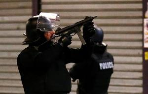 Police forces prepare in St. Denis, a northern suburb of Paris, Wednesday, Nov. 18, 2015. Authorities in the Paris suburb of St. Denis are telling residents to stay inside during a large police operation near France's national stadium that two officials say is linked to last week's deadly attacks. (AP Photo/Francois Mori)