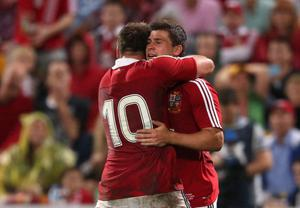 BRISBANE, AUSTRALIA - JUNE 08:  Ben Youngs of the Lions celebrates with team mate Owen Farrell (L) after scoring a try during the match between the Queensland Reds and the British & Irish Lions at Suncorp Stadium on June 8, 2013 in Brisbane, Australia.  (Photo by David Rogers/Getty Images)