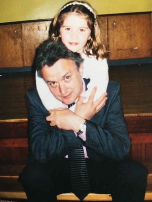 Cara Hunter with her dad, 2003, at her Holy Communion.