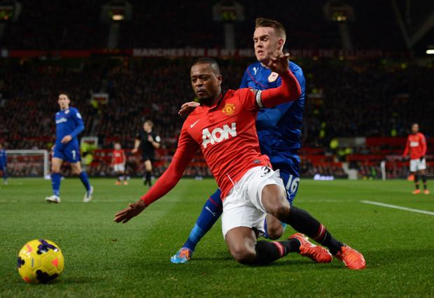 MANCHESTER, ENGLAND - JANUARY 28:  Patrice Evra of Manchester United tangles with Craig Noone of Cardiff City during the Barclays Premier League match between Manchester United and Cardiff City at Old Trafford on January 28, 2014 in Manchester, England.  (Photo by Michael Regan/Getty Images)