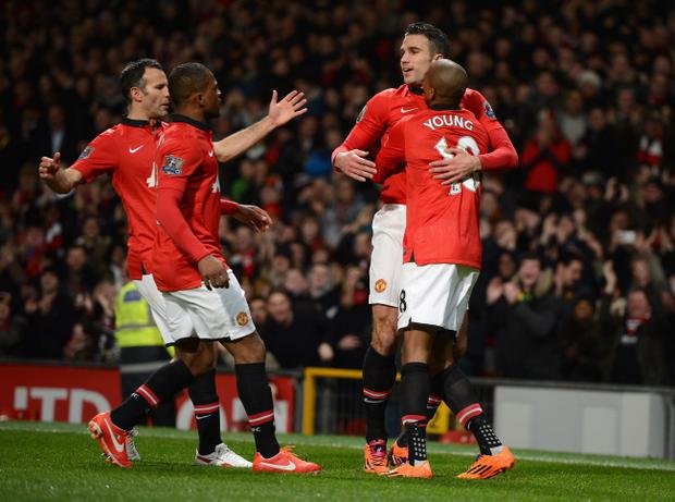 MANCHESTER, ENGLAND - JANUARY 28:  Robin van Persie of Manchester United celebrates scoring the opening goal with his team-mates during the Barclays Premier League match between Manchester United and Cardiff City at Old Trafford on January 28, 2014 in Manchester, England.  (Photo by Michael Regan/Getty Images)