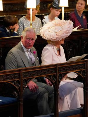 WINDSOR, UNITED KINGDOM - MAY 19: (L-R) Prince Charles, Prince of Wales, Camilla, Duchess of Cornwall take their seats at St George's Chapel at Windsor Castle before the wedding of Prince Harry to Meghan Markle on May 19, 2018 in Windsor, England. (Photo by  Jonathan Brady - WPA Pool/Getty Images)
