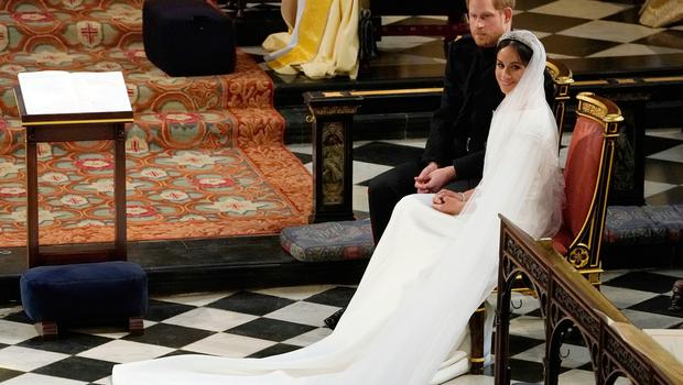 Prince Harry and Meghan Markle in St George's Chapel at Windsor Castle during their wedding service. PRESS ASSOCIATION Photo. Picture date: Saturday May 19, 2018. See PA story ROYAL Wedding. Photo credit should read: Owen Humphreys/PA Wire