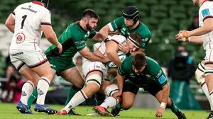 Ulster's Matty Rea is tackled by Matthew Burke, Eoghan Masterson and Dave Heffernan of Connacht (Pic: INPHO/Billy Stickland)