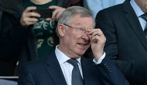 Sir Alex Ferguson in the stands before kick-off of the UEFA Champions League Quarter Final match Old Trafford, Manchester