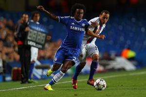 LONDON, ENGLAND - SEPTEMBER 18:  Willian of Chelsea and Marcelo Diaz of FC Basel battle for the ball during the UEFA Champions League Group E Match between Chelsea and FC Basel at Stamford Bridge on September 18, 2013 in London, England.  (Photo by Clive Rose/Getty Images)