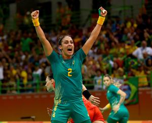 RIO DE JANEIRO, BRAZIL - AUGUST 08:  Fabiana Diniz #2 of Brazil celebrates after teammate Barbara Arenhart made a save in the first half against Romania on Day 3 of the Rio 2016 Olympic Games at the Future Arena on August 8, 2016 in Rio de Janeiro, Bra  (Photo by Elsa/Getty Images)