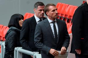 Former Liverpool manager Brendan Rogers (R), and former Liverpool player Jamie Carragher (C) arrive for a memorial service at Anfield in Liverpool, north west Engand on April 15, 2016, on the 27th anniversary of the Hillsborough Disaster. 96 Liverpool supporters died at the 1989 FA Cup semi-final between Liverpool and Nottingham Forest at the Hillsborough football ground in Sheffield, northern England. 2016 will be the final year a memorial service is held at Anfield. / AFP PHOTO / PAUL ELLISPAUL ELLIS/AFP/Getty Images