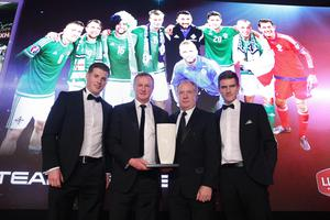 Team of the Year winner: Northern Ireland football team. Manager Michael O'Neill and assistant coach Jimmy Nicholl collect the trophy on behalf of the team from champion cyclist Martyn Irvine and Patrick Woods, Director of Linwoods. Picture by Kelvin Boyes/ Press Eye