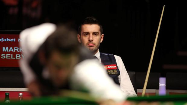 Mark Selby (right) looks on dejected as Ronnie O'Sullivan racks up the points during the 2014 Dafabet Masters at Alexandra Palace, London. PRESS ASSOCIATION Photo. Picture date: Sunday January 19, 2014. See PA story SNOOKER Masters. Photo credit should read: John Walton/PA Wire