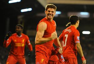 Steven Gerrard of Liverpool celebrates scoring their third goal from the penalty spot during the Barclays Premier League match between Fulham and Liverpool at Craven Cottage on February 12, 2014 in London, England