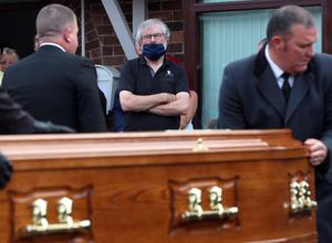 Gerry Adams looks on as the body of leading Republican Bobbie Storey is returned to his Anderstown home.